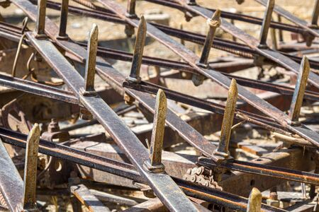 Close up of old rusty harrow for agriculture