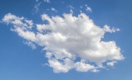 White cloud on a blue sky as a background, screensavers on a computer, creativity for design. Фото со стока