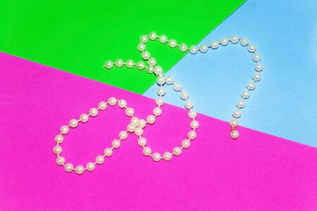 Beads on a colored background. Close-up.