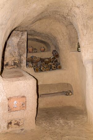 The ancient dwelling of the Kazakhs in the dugout. Inside view. Banco de Imagens