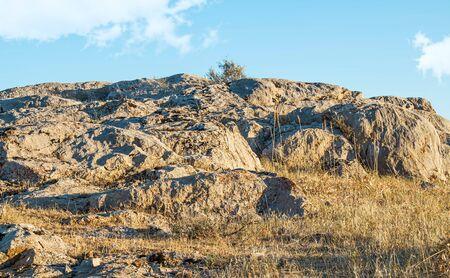 Stones rocks rocky ground against the sky