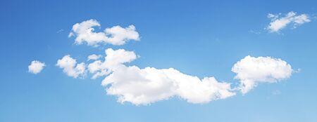 White cloud on a blue sky as a background, screensavers on a computer, creativity for design. Banco de Imagens