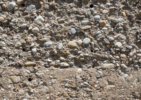 Wall of gravel and concrete as background