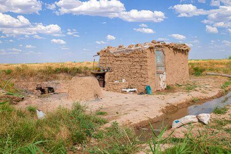 Temporary dwelling Cottage in a clay field in Kazakhstan. Rural landscape Banco de Imagens