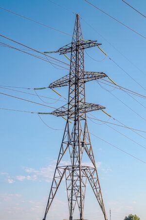 Metal pylons of high-voltage power lines against the sky Banco de Imagens