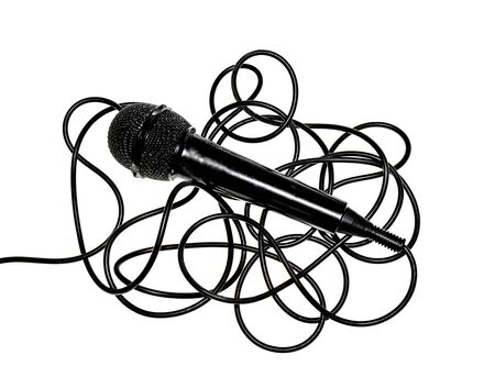Black microphone with black wire on a white background Stock Photo