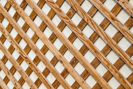 Wooden slat rack on the wall as background