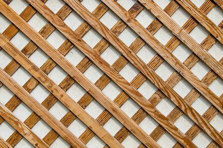 Rejilla de listones de madera en la pared como fondo