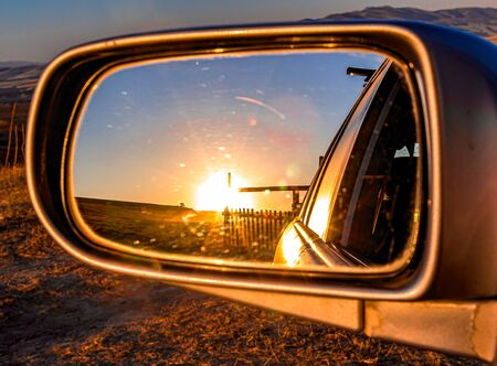 Auto on the background of the sunrise