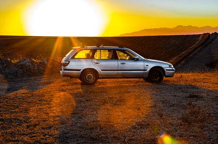 Shymkent, Kazakhstan - July 15, 2019; Auto brand Mazda on the background of the sunrise