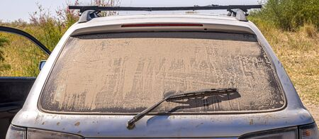 Dust and dirt on the rear window of a car
