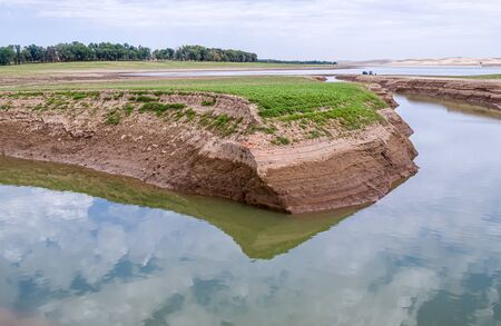 Steep washed banks of the river. Landscape Stock Photo