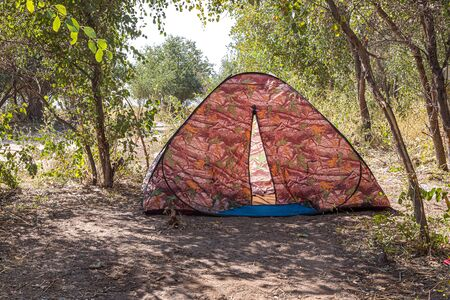 Tourist tent under the trees in nature