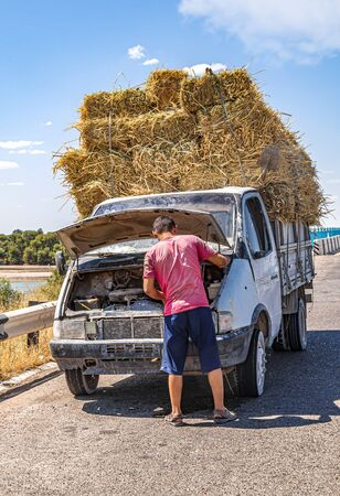 Car broke down on the road. Overheating. Transportation of hay