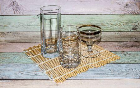Empty glassware lit by the sun. Stock Photo