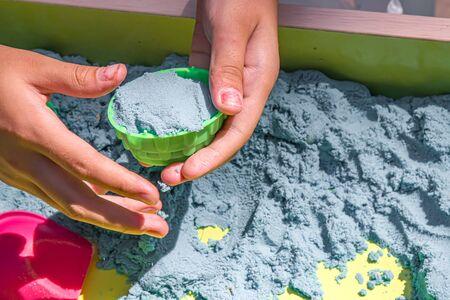 Children build kinetic sand figures 写真素材