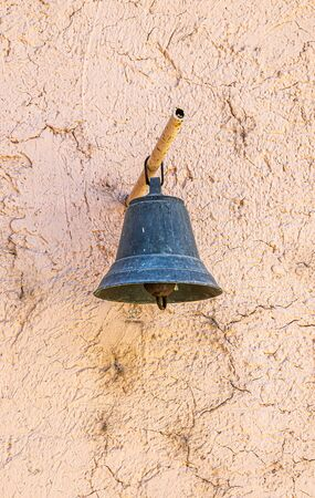 Old church bell on the wall background