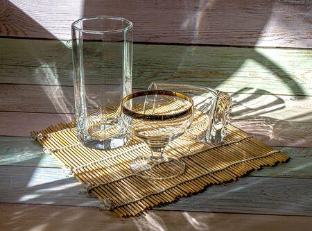 Empty glassware lit by the sun. 写真素材