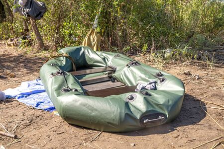 Inflatable fishing boat on the shore