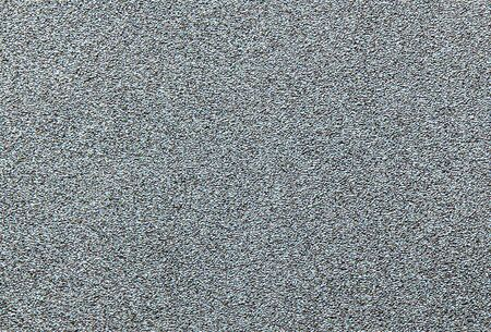 Wall of gray granular material as a background