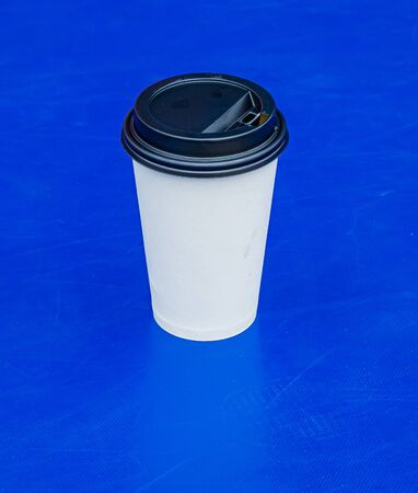 Plastic cup with water on a blue background