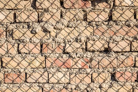 Wall made of metal mesh netting as a basis for plastering background for design Фото со стока - 131887505