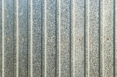Galvanized profiled sheet wall as background for design
