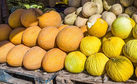 Ripe melons on the collective farm market. Selective focus.