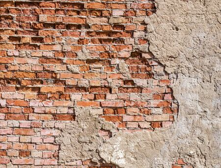 Old collapsing brick wall. Selective focus