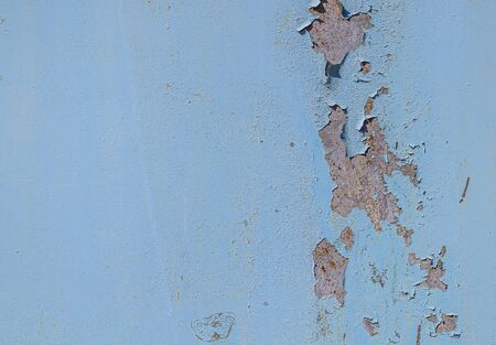 Old rusty painted metal surface as background