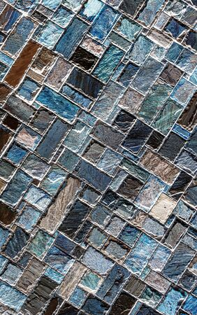 Wall of colored artificial stone as a background. Stock Photo