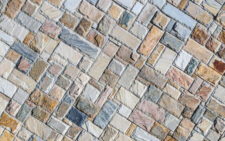 Wall of colored artificial stone as a background. Stok Fotoğraf