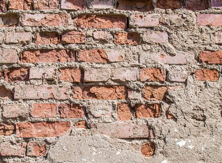 Wall of old weathered brick as a background