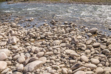 Big Stones on the bank of a mountain river Stok Fotoğraf