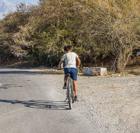 Cycling on a country road. Travel. Scenery. Stock Photo