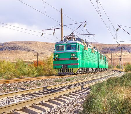 Railway. Train on the railway in the fall.