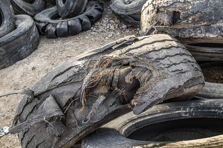 Garbage dump of old tires. Rubber recycling. 写真素材