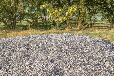 Large pile of building gravel outdoors