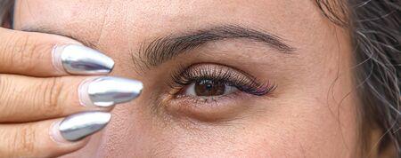 Poorly made up female eye close-up