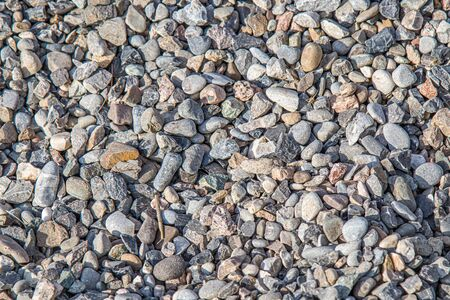 A large pile of building gravel outdoors as a background