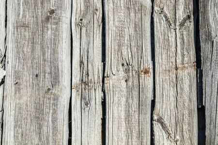 Fence wall made of old weathered wooden boards as background 写真素材