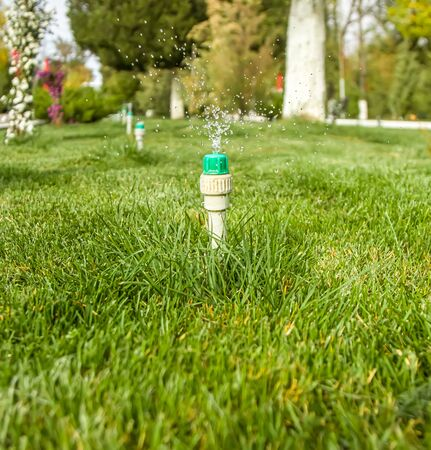 A device for watering the lawn in the park
