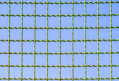 Metal mesh against the blue sky.