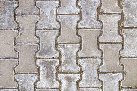 Salt on paving slabs outdoors