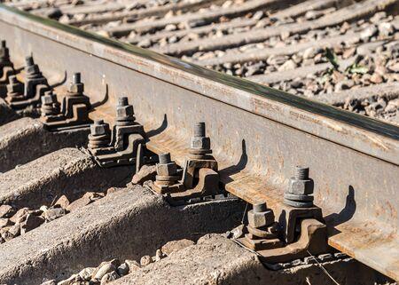 Fastenings of metal railway rails close-up Standard-Bild