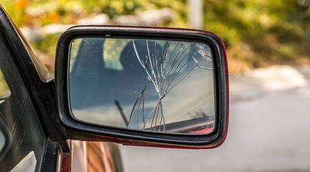 Broken mirror of a passenger car close-up