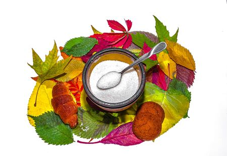 Sugar in a sugar bowl on a white background