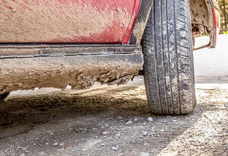 Dried dirt on a car in the fresh air close-up