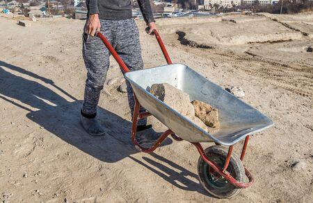 Wheelbarrow at the archaeological site. Manual labor.