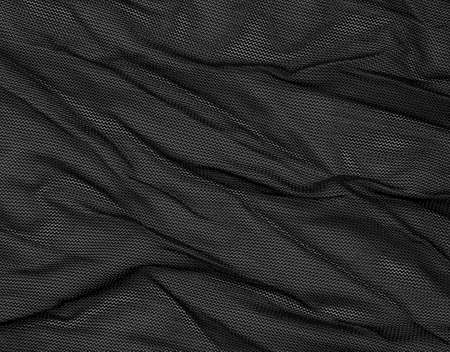 Black mesh fabric as background.